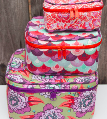 Train Cases fra Crimson and Clover. Designer Sara Lawson.