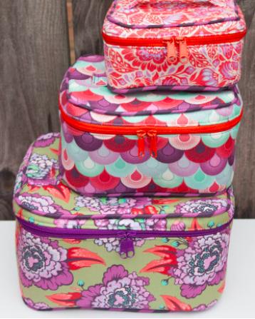 Train Cases fra Crimson and Clover. Designer Sara Lawson.